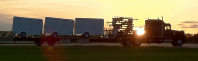trucks in front of sunset